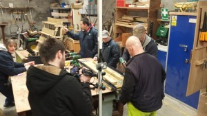Learning disability services in Solihull offers woodworking for project workers at Newlands Bishop Farm, part of the Family Care Trust